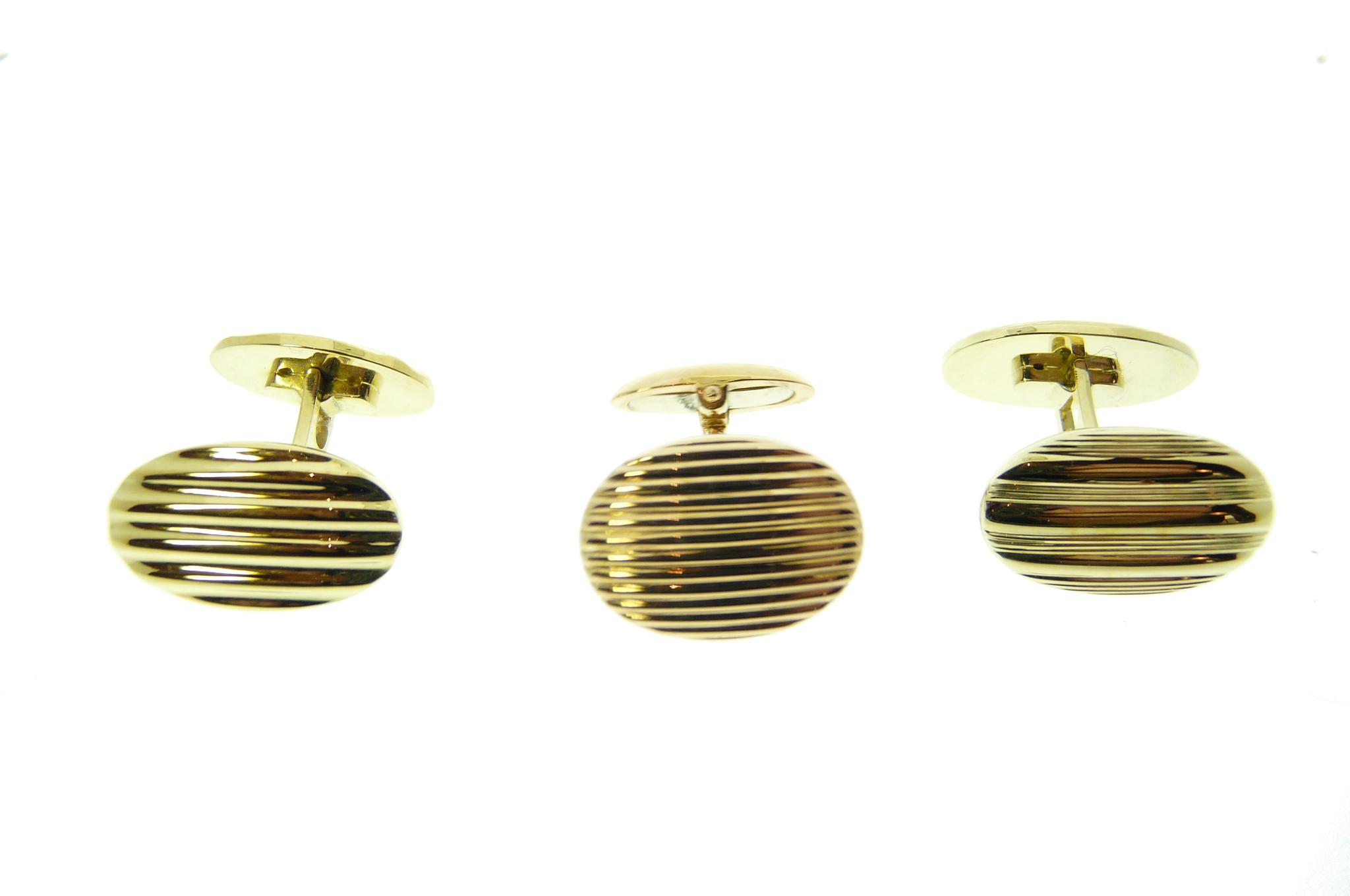 Gouden manchetknopen en jumelles