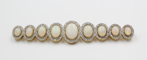 Gouden broche met diamant en opaal