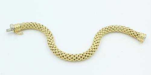 18 kt gouden armband flexibel, rond,merk FOPE ( Italia) 7 mm