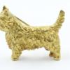 Een 18 kt geelgouden West Highland terrier , vervaardigd in Engeland. 16.7 gram